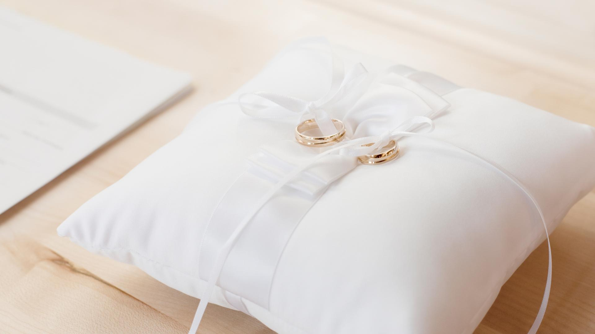 Testimonials Image of wedding rings on a beautiful pillow