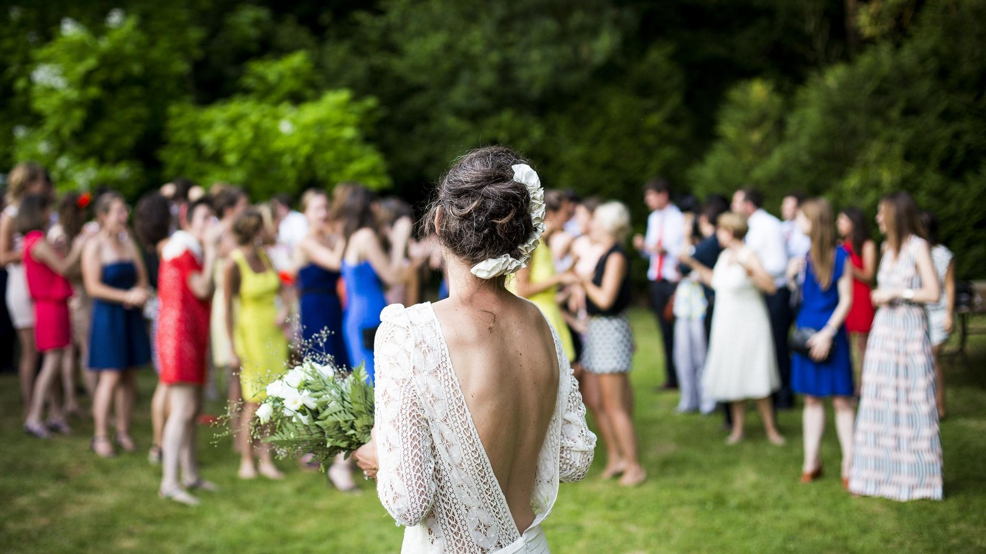 A photo of a bride looking at the guests on her wedding