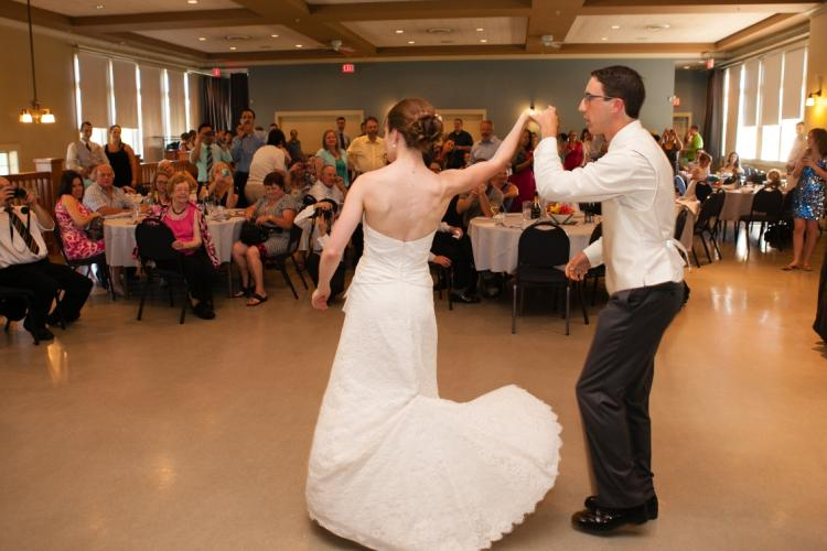 A bride and groom dancing at the Alan Emmott Centre