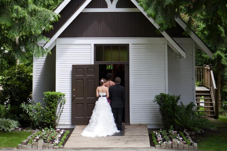 Couple walks down the aisle at the Burnaby Village Museum church