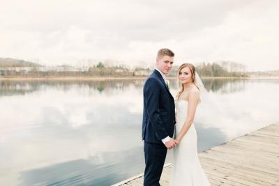Newly weds posing by the lake
