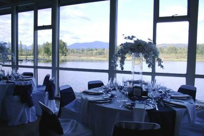 Room set up for event. View of lake through windows