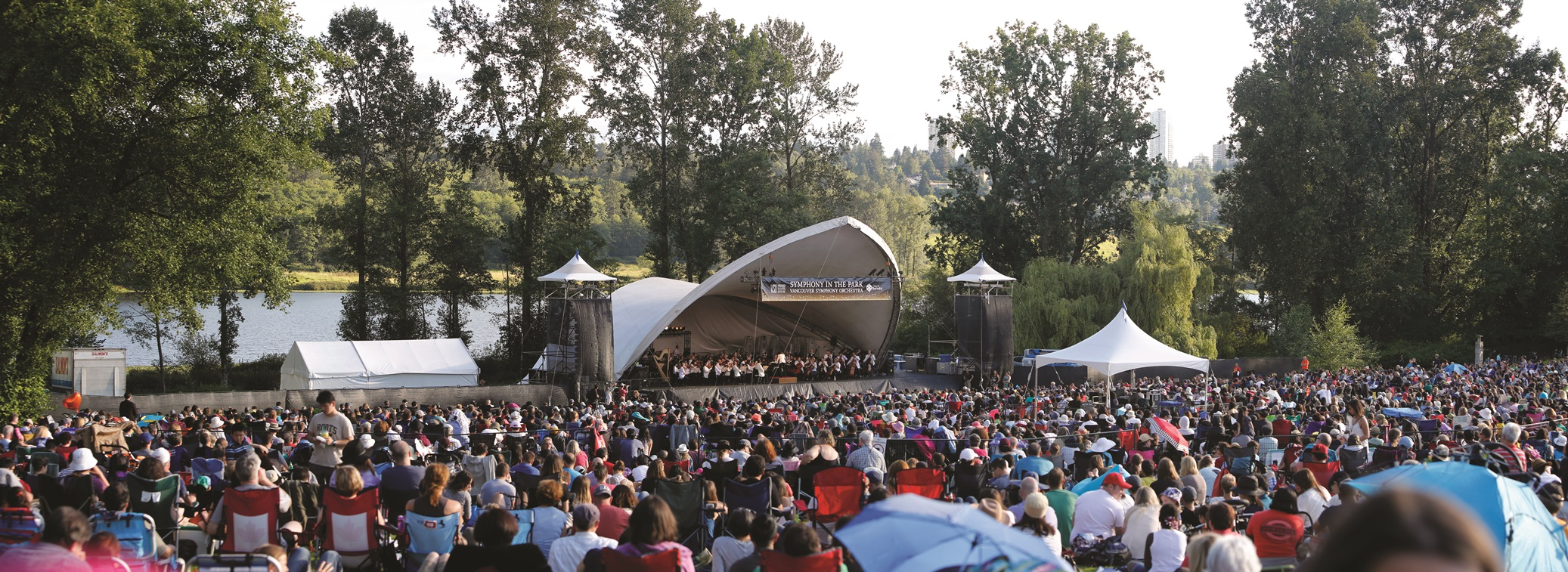 Panorama of the VSO tent and concert goers at the Symphony in the Park